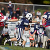 Jared Charney / Photo Amesbury's Alan Fowler can't quite tackle Hamilton-Wenham's Andrew Riccio, Saturday, October 15, 2016.