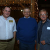 DAVID LE/Staff photo. Scott McAllister, Alex Danish, and Library Trustee Don McAllister at the Starry, Starry Night Fundraiser held at the Smith Barn on Brooksby Farm. 10/6/16.