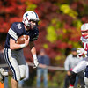 Jared Charney / Photo Hamilton-Wenham's Phillip Durgin charges for a first down against Amesbury, Saturday, October 15, 2016.