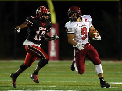DAVID LE/Staff photo. Gloucester captain Christian Sanfilippo (9) turns the corner while being chased down by Salem junior Jeffery Rodriguez (10). 10/14/16.