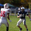 Jared Charney / Photo Hamilton-Wenham's Andrew Riccio takes the opening kick off against Amesbury, Saturday, October 15, 2016.