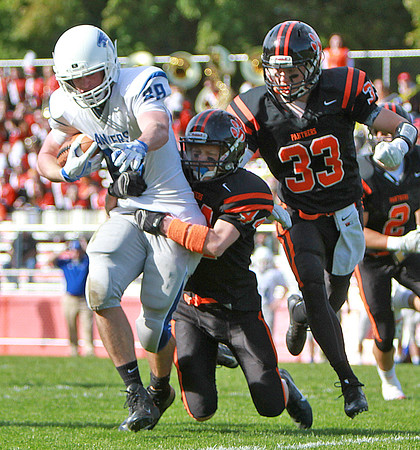 Danvers' Kieran Moriarty carries the ball as Beverly's Johnny Jones brings him down  in a game Saturday, October 15, at Hurd Stadium. Photo by Nicole Goodhue Boyd