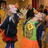 RYAN HUTTON/ Staff photo<br /> Emma Silvi, 11, dressed as a lady bug, left, and Hannah Fessenden, 11, dressed an a ninja turtler, right, compete in the donut-on-a-string eating contest at the Peabody Halloween celebration at the Knights of Columbus hall on Thursday.