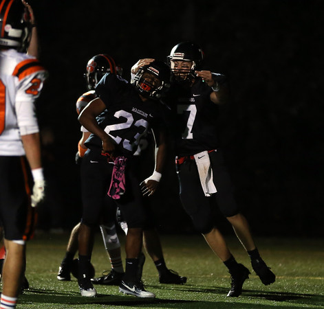DAVID LE/Staff photo. Marblehead senior Jaason Lopez (23) celebrates his first half touchdown against Beverly with senior quarterback Drew Gally, right. 10/7/16.