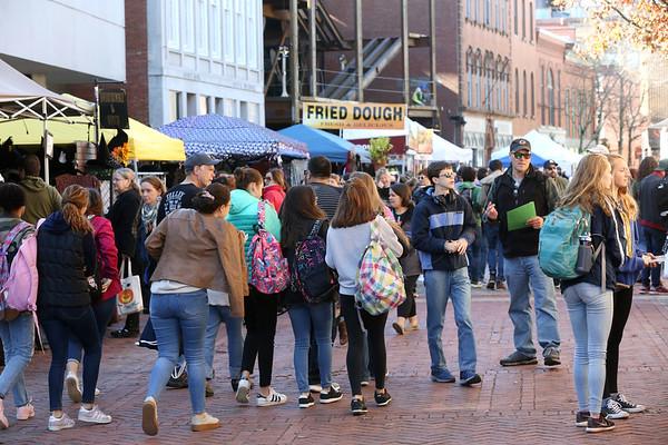 Tourists crowd Essex Street