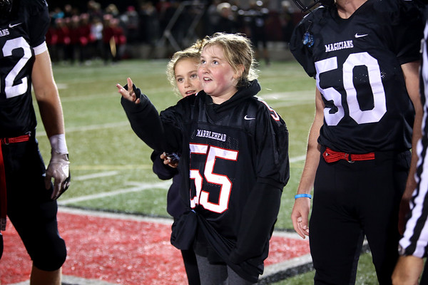 HADLEY GREEN/Staff photo<br /> Marblehead's Sophia Smith tosses the game coin at the beginning at the Marblehead v. Gloucester varsity football game at Marblehead High School. 10/13/17