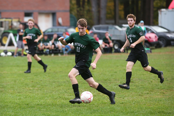 HADLEY GREEN/Staff photo<br /> Pentucket's Patrick Dillon (11) moves the ball down the field at the Masconomet v. Pentucket boys varsity soccer game at Masconomet High School.<br /> <br /> 10/24/17