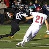 HADLEY GREEN/Staff photo<br /> Marblehead's Derek Marino (85) runs with the ball as Gloucester's Harrison Marshall (21) defends him at the Marblehead v. Gloucester varsity football game at Marblehead High School. 10/13/17