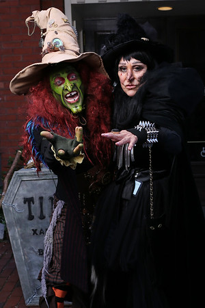 "HADLEY GREEN/Staff photo<br /> ""What Halloween means to me is bringing lots of smiles and happiness and spooks to all the kids, young and old,"" says Brian Sims, left, who plays the witch character, ""Borah Brewington Snaggletooth the 13th. "" Sims stands on Essex Street with fellow street performer Priscilla Davis, who plays witch ""Xander Diamond.""<br /> <br /> 10/31/17"