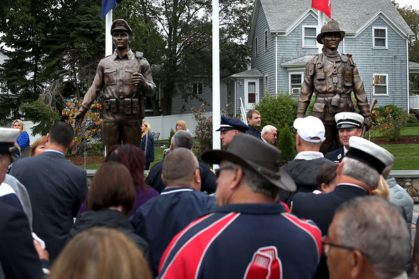 HADLEY GREEN/Staff photo<br /> The new Peabody Police and Fire Memorial on Perkins Street was unveiled at a ceremony Saturday morning. 10/14/170/14/17
