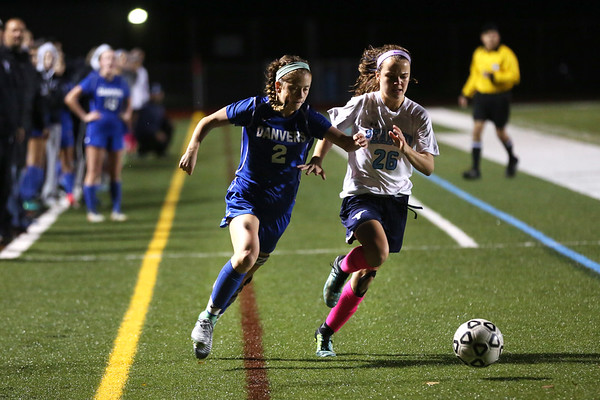 HADLEY GREEN/Staff photo<br /> Danvers' Lauren Clement (2) and Peabody's Bridget O'Connell (26) fight for the ball at the Peabody v. Danvers girls soccer game at Peabody High School.<br /> <br /> 10/25/17