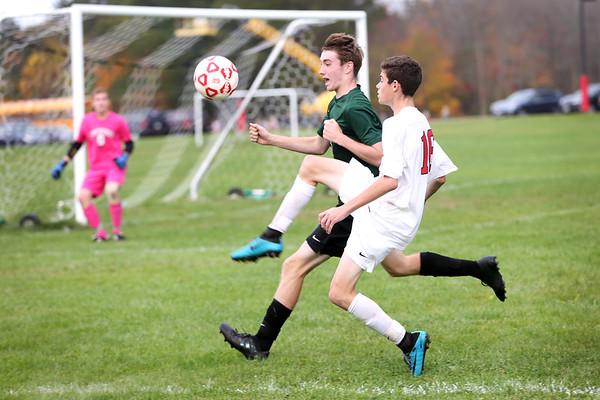 HADLEY GREEN/Staff photo<br /> Masconomet's Josh Rubin (16) chases the ball at the Masconomet v. Pentucket boys varsity soccer game at Masconomet High School.<br /> <br /> 10/24/17