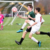 HADLEY GREEN/Staff photo<br /> Masconomet's Josh Rubin (16) chases the ball at the Masconomet v. Pentucket boys varsity soccer game at Masconomet High School.<br /> <br /> 10/24/17