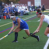 HADLEY GREEN/Staff photo<br /> Danvers' Erica Haibon (15) and Marblehead's Josie Friedman (6) vie for the ball at the Marblehead v. Danvers girls field hockey game.<br /> 09/30/17