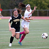 HADLEY GREEN/Staff photo<br /> Beverly's Ava Boghosian (4) and Bishop Fenwick's Lauren Baker (7) vie for the ball at the Beverly v. Bishop Fenwick varsity girls soccer game at the Hurd Stadium in Beverly. 10/07/17