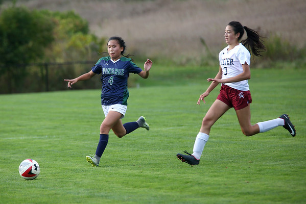 HADLEY GREEN/Staff photo<br /> Pingree's Mei Li Hart (4) sprints to the ball at the Pingree v. Phillips Exeter girls soccer game at the Pingree School. 10/11/17