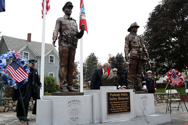 HADLEY GREEN/Staff photo<br /> The new Peabody Police and Fire Memorial on Perkins Street was unveiled at a ceremony Saturday morning. 10/14/17