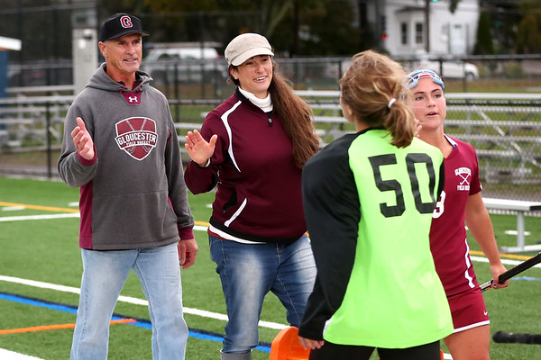 HADLEY GREEN/Staff photo<br /> Coaches Lauren and Don Riley high-five players after the Swampscott v. Peabody girls field hockey game at the Blocksidge Field in Swampscott.<br /> 10/26/17