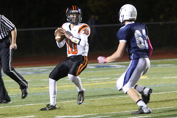 HADLEY GREEN/Staff photo<br /> Beverly's Nick Berry (10) scans the field for an open pass at the Peabody v. Beverly football game at Peabody High School.<br /> <br />  10/20/17