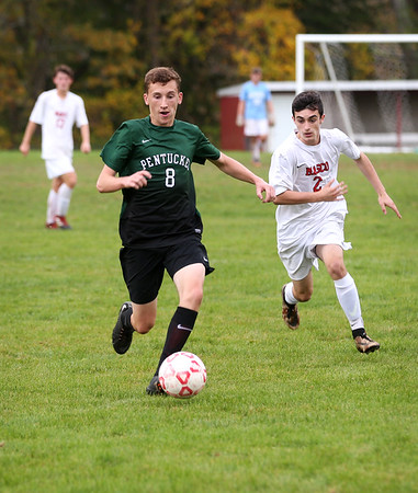 HADLEY GREEN/Staff photo<br /> Pentucket's Patrick Sullivan (8) chases the ball while Masconomet's Dom Gecoya (2) runs behind him at the Masconomet v. Pentucket boys varsity soccer game at Masconomet High School.<br /> <br /> 10/24/17