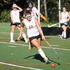 HADLEY GREEN/Staff photo<br /> Marblehead's Holly Rowe (12) moves the ball at the Marblehead v. Danvers girls field hockey game.<br /> 09/30/17