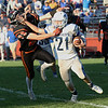 HADLEY GREEN/Staff photo<br /> Danvers' Colby Holland (21) fights off Beverly defender Duncan Moreland (23) at the Beverly v. Danvers football game at the Hurd Stadium in Beverly. 10/14/17