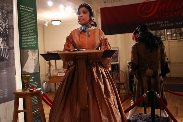 """HADLEY GREEN/Staff photo<br /> Actress Kathy-Ann Hart, playing the role of Salem abolitionist Sarah Parker-Remond, gives a speech at the ceremony to unveil a new display at the Salem Museum titled """"Salem, Slavery & Abolition."""" <br /> <br />  10/18/17"""