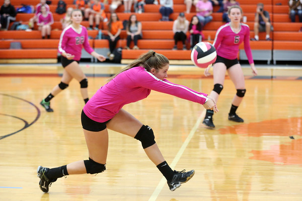 """HADLEY GREEN/Staff photo<br /> Beverly's Sydney Wiley (1) returns the ball at the Beverly v. Winthrop girls volleyball """"Dig Pink"""" game. 10/06/17"""