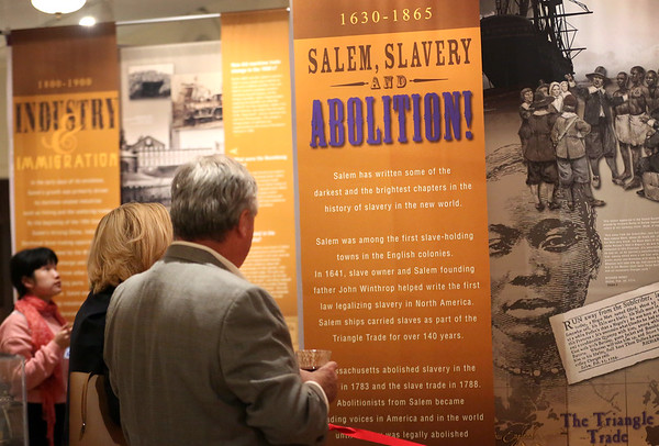 """HADLEY GREEN/Staff photo<br /> People look at a new display at the Salem Museum titled """"Salem, Slavery & Abolition."""" The exhibit focuses on Salem's transition from a slave-holding town to a hub for abolitionist voices in the 17th and 18th century. The display is open to the public until the museum closes for the season on October 31st. <br /> <br />  10/18/17"""