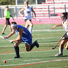 HADLEY GREEN/Staff photo<br /> Danvers' Erica Haibon (15) runs towards the ball at the Marblehead v. Danvers girls field hockey game.<br /> 09/30/17
