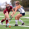 HADLEY GREEN/Staff photo<br /> Gloucester's Rachel Rallo (6) and Swampscott's Maddie O'Brien (15) vie for the ball at the Swampscott v. Peabody girls field hockey game at the Blocksidge Field in Swampscott.<br /> 10/26/17