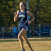 AMANDA SABGA/Staff photo. <br /> <br /> Hamilton-Wenham's Becca Erhard finishes in second during a cross country meet between Manchester Essex and Hamilton-Wenham at Patton Park in Hamilton. <br /> <br /> 10/18/17