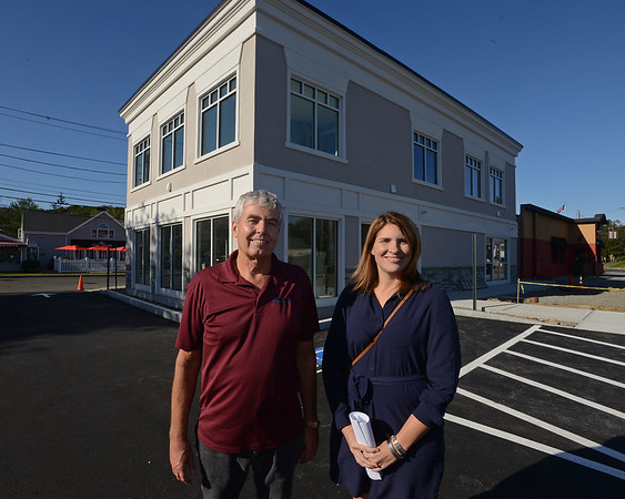 RYAN HUTTON/ Staff photo<br /> Michael Welch, left, and Meg Kubera, right, stand in the parking lot of the building they are developing on Loring Avenue in Salem which is connected to the Vesuvius restaurant.