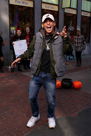 HADLEY GREEN/Staff photo<br /> Isaias Morales, a junior at Salem High, performs with Salem High's acapella group WitchPitch on Essex Street on Halloween. <br /> <br /> 10/31/17