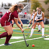 HADLEY GREEN/Staff photo<br /> Gloucester's Baily Marshall (12) runs towards the goal at the Swampscott v. Peabody girls field hockey game at the Blocksidge Field in Swampscott.<br /> 10/26/17