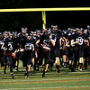 HADLEY GREEN/Staff photo<br /> Marblehead players charge onto the field at the beginning of the Marblehead v. Gloucester varsity football game at Marblehead High School. 10/13/17