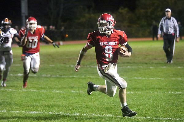 HADLEY GREEN/Staff photo<br /> Masconomet's Matt Brockelman (8) sprints with the ball to make a touchdown at the Masconomet v. Woburn football game at Masconomet High School.<br /> <br /> 10/27/17