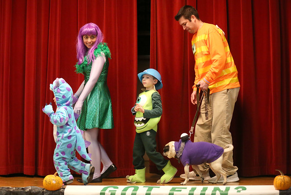 """HADLEY GREEN/Staff photo<br /> From left, Austin, Jennifer, Aiden, Brady, and Bob Pavenski of Middleton dressed up as """"Monsters Inc."""" for the Nightmare on Main Street costume contest at the Knights of Columbus in Peabody. <br /> 10/25/17"""