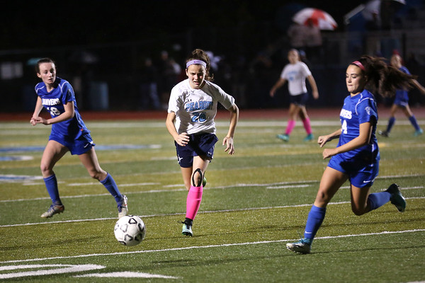 HADLEY GREEN/Staff photo<br /> Peabody's Bridget O'Connell (26) sprints towards the ball at the Peabody v. Danvers girls soccer game at Peabody High School.<br /> <br /> 10/25/17