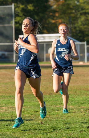 AMANDA SABGA/Staff photo. <br /> <br /> Hamilton-Wenham's Grace Moroney is trailed by teammate Jemma Shea during a cross country meet between Manchester Essex and Hamilton-Wenham at Patton Park in Hamilton. <br /> <br /> 10/18/17