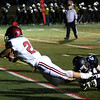 HADLEY GREEN/Staff photo<br /> Gloucester's Jan Pena-Ortiz (28) dives for a touchdown while Marblehead's Jack McGrath (24) defends him at the Marblehead v. Gloucester varsity football game at Marblehead High School. 10/13/17