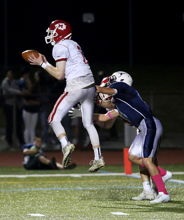 HADLEY GREEN/Staff photo<br /> Masconomet's Colby Jacques (2) jumps to intercept the ball intended for Peabody's Dylan Peluso (9) at the Peabody v. Masconomet varsity football game. 10/06/17