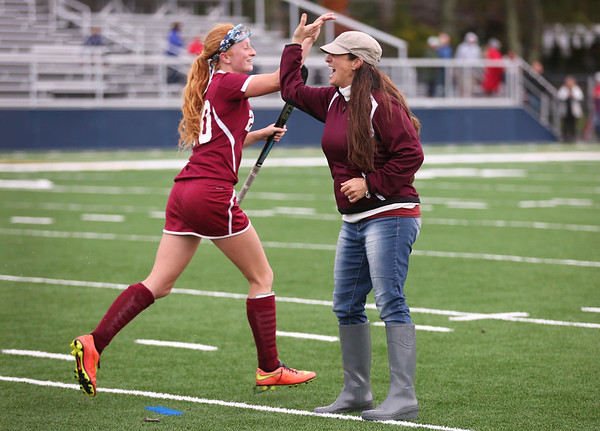 HADLEY GREEN/Staff photo<br /> Gloucester's Tracy Wood (20) high-fives her coach Lauren Riley after winning against Swampscott. <br /> 10/26/17