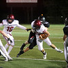 HADLEY GREEN/Staff photo<br /> Gloucester's Marc Smith (32) barrels through Marblehead defenders at the Marblehead v. Gloucester varsity football game at Marblehead High School. 10/13/17