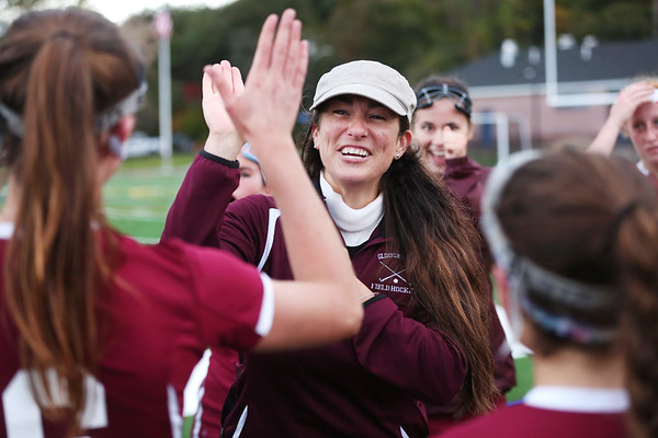 HADLEY GREEN/Staff photo<br /> Gloucester coach Lauren Riley celebrates with her players after winning against Swampscott. <br /> <br /> 10/26/17