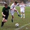 HADLEY GREEN/Staff photo<br /> Masconomet's Josh Rubin (16) and Pentucket's Patrick Dillon (11) vie for the ball at the Masconomet v. Pentucket boys varsity soccer game at Masconomet High School.<br /> <br /> 10/24/17