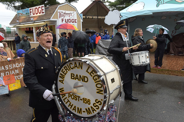TIM JEAN/Staff photo<br /> Mario Taricano, left, sings and plays the drum with other members of Waltham's American Legion Post 156 Marching Band as they walk thru the fair grounds during the Grand Parade and opening ceremonies of the Topsfield Fair. 9/30/17