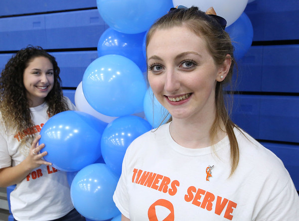 Ken Yuszkus/Staff photo      Ann Manning, right,  stands with the captain of the volley ball team, Serena Lavo, left,.  The Peabody High School volley ball team raised money for Leukemia research, inspired by the passing of teammate Ann Manning's father.      10/27/17