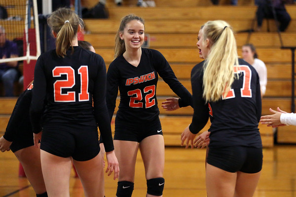 HADLEY GREEN/ Staff photo<br /> Ipswich players celebrate after scoring at the Hamilton-Wenham v. Ipswich girls volleyball game. <br /> <br /> 10/15/2018