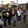 HADLEY GREEN/ Staff photo<br /> Throngs of people walk through the midway at the Topsfield Fair. <br /> <br /> 10/08/2018